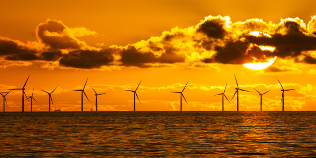 MORECAMBE BAY, UNITED KINGDOM - FEBRUARY 06: Sunset over the Walney offshore Wind farm from Walney island showing both the wind turbines and a gas platform further out in Morecambe Bay on February 06, 2017 in Morecambe Bay, England .The windfarm will shortly be the largest offshore wind farm in the world and currently generates 367 MW.PHOTOGRAPH BY Ashley Cooper / Barcroft ImagesLondon-T:+44 207 033 1031 E:hello@barcroftmedia.com -New York-T:+1 212 796 2458 E:hello@barcroftusa.com -New Delhi-T:+