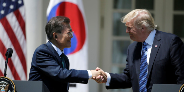 U.S. President Donald Trump (R) greets South Korean President Moon Jae-in prior to delivering a joint statement from the Rose Garden of the White House in Washington, U.S., June 30, 2017. REUTERS/Jim Bourg     TPX IMAGES OF THE DAY