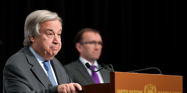 UN Secretary General Antonio Guterres (L) speaks during a press conference flanked by Special Adviser of the UN Secretary-General on Cyprus, Norvegian Espen Barth Eide (rear C) during peace talks on June 30, 2017 in the Swiss resort of Crans-Montana.More than 40 years after Turkish troops invaded northern Cyprus, the presence of tens of thousands of soldiers on the Mediterranean island still looms large over make-or-break peace negotiations this week. / AFP PHOTO / Fabrice COFFRINI        (Photo