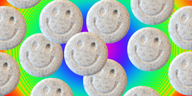 Ecstasy. Tablets of the illegal drug ecstasy (3, 4- methylenedioxymethamphetamine or MDMA). Ecstasy induces feelings of elation, energy and well- being. Possible side effects include dehydration, involuntary muscle movements and psychological difficulties. There is some evidence that long term use may cause brain damage. The \smiley\ symbol on the tablets was an emblem adopted by the 1980s acid house dance music culture that popularised the use of ecstasy as a recreational drug.