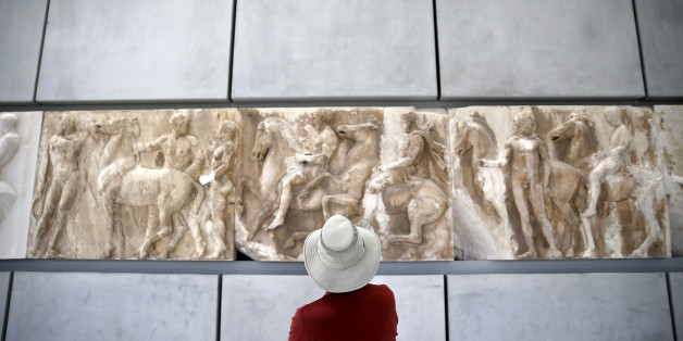 A man looks at exhibits at the Parthenon hall of the Acropolis museum in Athens, Greece, May 18, 2015. REUTERS/Alkis Konstantinidis/File Photo