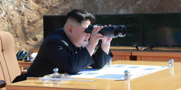 This picture taken and released on July 4, 2017 by North Korea's official Korean Central News Agency (KCNA) shows North Korean leader Kim Jong-Un inspecting the test-fire of intercontinental ballistic missile Hwasong-14 at an undisclosed location.North Korea declared on July 4 it had successfully tested its first intercontinental ballistic missile -- a watershed moment in its push to develop a nuclear weapon capable of hitting the mainland United States. / AFP PHOTO / KCNA VIA KNS / STR / South