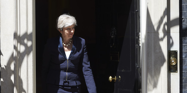 Britain's Prime Minister Theresa May exits No 10 Downing St to greet Ukraine Prime Minister, Volodymyr Groysman, in central London on July 5, 2017. / AFP PHOTO / NIKLAS HALLE'N        (Photo credit should read NIKLAS HALLE'N/AFP/Getty Images)