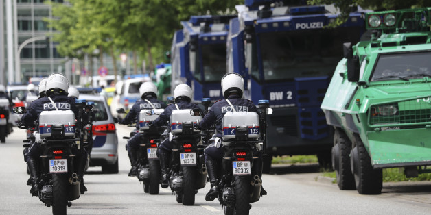 Austrian police officers ride on motorbikes ahead of the G20 summit in Hamburg, Germany, July 5, 2017. REUTERS/Kai Pfaffenbach