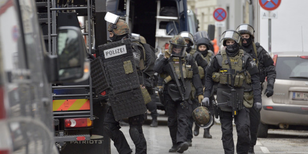Police commandos raid the club house of the Hells Angels in Vienna, Austria on January 4, 2017. A German murder suspect was arrested during the raid. / AFP / APA / HANS PUNZ / Austria OUT        (Photo credit should read HANS PUNZ/AFP/Getty Images)