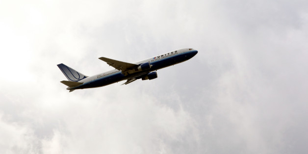 General view of an United Airlines plane taking off at Heathrow Airport