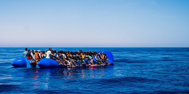 MEDITERRANEAN SEA, LIBYA - JUNE 15 :  Spanish SAR plane patrols as refugees wait to get on onboard the rescue vessel Golfo Azzurro by members of the Spanish NGO Proactiva Open Arms, after being rescued from a wooden boat sailing out of control in the Mediterranean Sea near Libya on Thursday, June 15, 2017. A Spanish aid organization Thursday rescued 420 migrants who were attempting the perilous crossing of the Mediterranean Sea to Europe in packed boats from Libya. (Photo by Marcus Drinkwater/An
