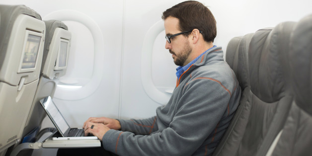 A man uses his laptop to test a new high speed inflight Internet service named Fli-Fi while on a special JetBlue media flight out of John F. Kennedy International Airport in New York December 11, 2013. Wi-Fi in the sky is taking off, promising much better connections for travelers and a bonanza for the companies that sell the systems. With satellite-based Wi-Fi, Internet speeds on jetliners are getting lightning fast. And airlines are finding that travelers expect connections in the air to rival