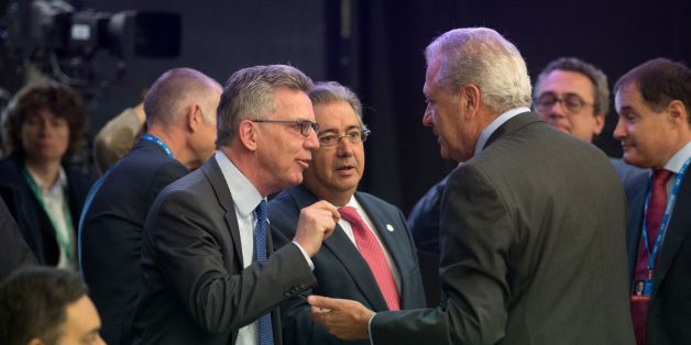 German Interior Minister Thomas de Maiziere (L) and his Spanish counterpart Juan Ignacio Zoido (C) talk with European Commissioner for Migration, Home Affairs and Citizenship Dimitris Avramopoulos prior an informal meeting of justice and home affairs Ministers at the Tallinn Creative Hub in Tallinn, Estonia on July 6, 2017. / AFP PHOTO / Raigo Pajula        (Photo credit should read RAIGO PAJULA/AFP/Getty Images)