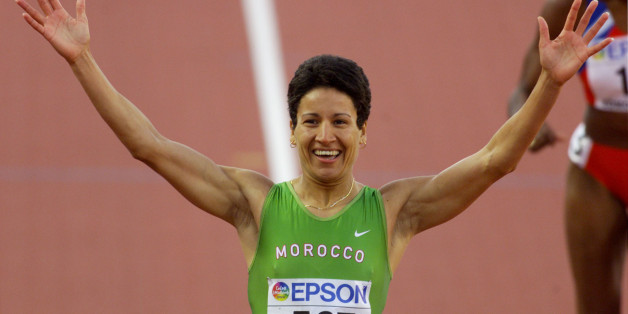 Nezha Bidouane of Morocco reacts after winning the women's 400 meterhurdles final at the World Championships in Athletics, in EdmontonAugust 8, 2001. Bidouane won in 53.34 seconds, Yuliya Nosova of Russiacame in second in 54.27 and Daimi Pernia of Cuba was third in 54.51.MMR/HB