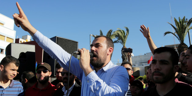 Moroccan activist and the leader of the protest movement Nasser Zefzafi gives a speech during a demonstration in the northern town of Al-Hoceima, seven months after a fishmonger was crushed to death inside a garbage truck as he tried to retrieve fish confiscated by the police, in Al-Hoceima, Morocco May 18, 2017. REUTERS/Youssef Boudlal