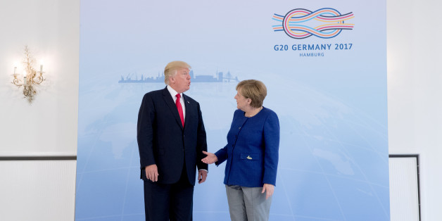 German Chancellor Angela Merkel meets U.S. President Donald Trump on the eve of the G-20 summit in Hamburg, Germany, July 6, 2017. REUTERS/Michael Kappeler/POOL