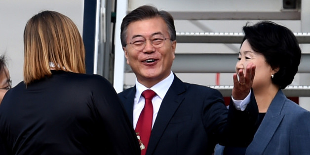 The President of South Korea Moon Jae-In (C) and his wife Kim Jeong-suk arrive at the airport in Hamburg, northern Germany on July 6, 2017 to attend the G20 meeting.Donald Trump arrived for high-stakes visit to Europe on July 5, landing in Poland ahead of his first G20 summit in Hamburg and a closely-watched meeting with Russian President Vladimir Putin.  / AFP PHOTO / PATRIK STOLLARZ        (Photo credit should read PATRIK STOLLARZ/AFP/Getty Images)