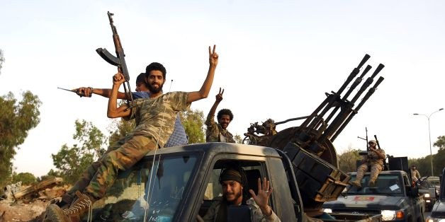 Members of the Salah Bou-Haliqa brigade, loyal to the country's east strongman Khalifa Haftar's self-styled Libyan National Army, celebrate as they arrive in the eastern city of Benghazi after seizing the central al-Jufra area from the Benghazi Defence Brigades coalition, a rival to Haftar's forces on June 5, 2017.  / AFP PHOTO / Abdullah DOMA        (Photo credit should read ABDULLAH DOMA/AFP/Getty Images)