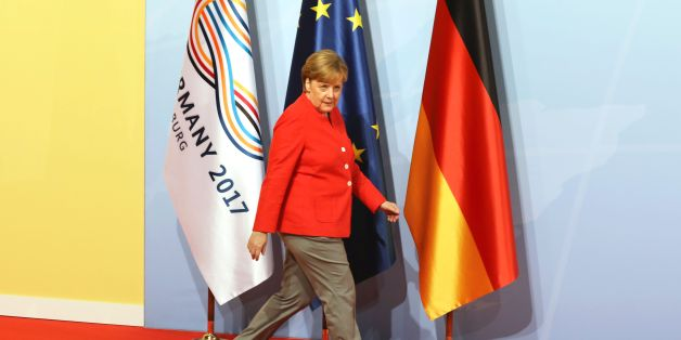 German Chancellor Angela Merkel walks past flags as she arrives before greeting heads of State at the start of the G20 meeting in Hamburg, northern Germany, on July 7.