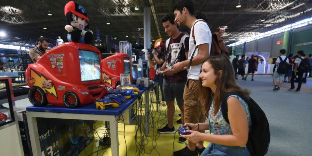 Young Tunisians play on a Nintendo 64 console during the opening of the second edition of Comic Con Tunisia on July 7, 2017, in the town of Le Kram, north of Tunis. / AFP PHOTO / FETHI BELAID        (Photo credit should read FETHI BELAID/AFP/Getty Images)