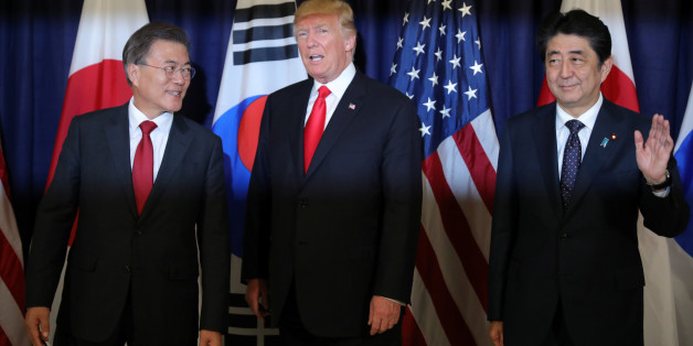 U.S. President Donald Trump meets South Korea's President Moon Jae-In and Japanese Prime Minister Shinzo Abe ahead the G20 leaders summit in Hamburg, Germany July 6, 2017.    REUTERS/Carlos Barria