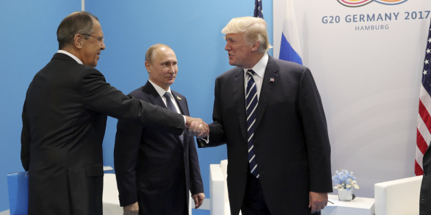 U.S. President Donald Trump (R) shakes hands with Russian Foreign Minister Sergei Lavrov as Russian President Vladimir Putin stands nearby during a meeting on the sidelines of the G20 summit in Hamburg, Germany July 7, 2017 Sputnik/Mikhail Klimentyev/Kremlin via REUTERS ATTENTION EDITORS - THIS IMAGE WAS PROVIDED BY A THIRD PARTY. EDITORIAL USE ONLY.