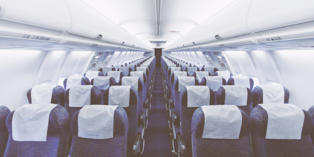 Modern Airplane seats in perspective. Transportation concept. Aircraft's corridor interior in modern tones.