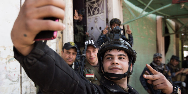 Direct at the frontline, 200 m far from the Al-Nuri-mosque, where Abu Bakr al-Baghdadi calles the so called Caliphate, fighters of the Federal Police are taking a selfie, in Mosul, Iraq, on April 2, 2017. (Photo by Sebastian Backhaus/NurPhoto via Getty Images)