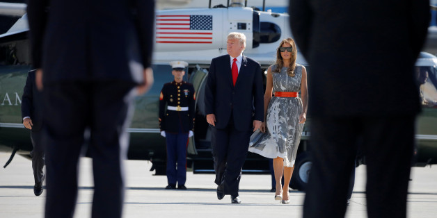 U.S. President Donald Trump and First Lady Melania Trump board Air Force One during their departure back to Washington, at Hamburg International Airport, in Hamburg, Germany, July 8, 2017. REUTERS/Carlos Barria