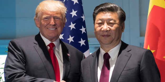 U.S. President Donald Trump and Chinese President Xi Jinping (R) shake hands prior to a meeting on the sidelines of the G20 Summit in Hamburg, Germany, July 8, 2017.  REUTERS/Saul Loeb, Pool