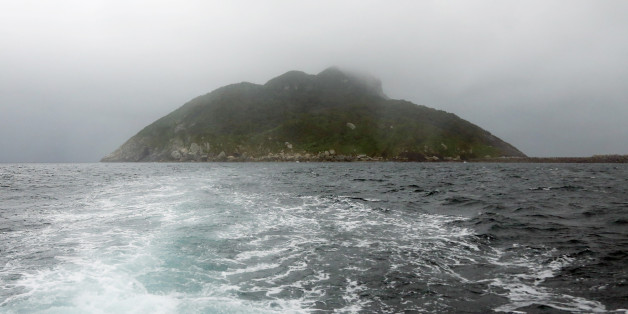 This September 30, 2016 picture shows a view of Okinoshima island, some 60 kilometres from Munakata city, Fukuoka prefecture.The island of Okinoshima and associted sites in the Munakata Region have been inscribed at the 41st session of the UNESCO World Heritage Committee held in Poland on July 9, 2017. / AFP PHOTO / JIJI PRESS / STR / Japan OUT        (Photo credit should read STR/AFP/Getty Images)