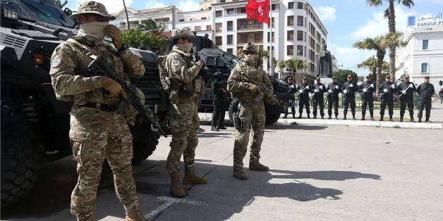 TUNIS, TUNISIA - MARCH 08: Tunisian soldiers take security measures during the opening of Battle of Ben Guerdane Exhibition at Habib Bourguiba Avenue in Tunis, Tunisia on March 08, 2017. 
