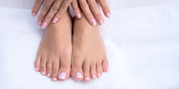 Manicure and pedicure concepts - close up on hands and feet at the beauty salon