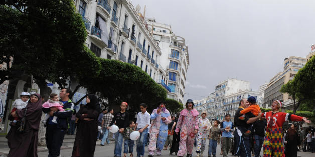 Algerian children with their families walk in Algiers' main street of Didouch Mourad on May 16, 2008 as the local municipality authorities called for a 'day without vehicles' in the capital's center. The municipality asked residents to walk, bike and ride on public transport instead of driving cars, for reducing pollution. AFP PHOTO/FAYEZ NURELDINE (Photo credit should read FAYEZ NURELDINE/AFP/Getty Images)