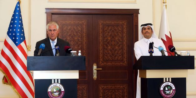 US Secretary of State Rex Tillerson and Qatari Foreign Minister Sheikh Mohammed bin Abdulrahman Al-Thani listen to questions by journalists during a press conference in Doha, on July 11, 2017.The US and Qatar announced they have signed an agreement on fighting terrorism, at a time when the emirate is facing sanctions from neighbouring countries which accuse it of supporting extremism. / AFP PHOTO / STRINGER        (Photo credit should read STRINGER/AFP/Getty Images)