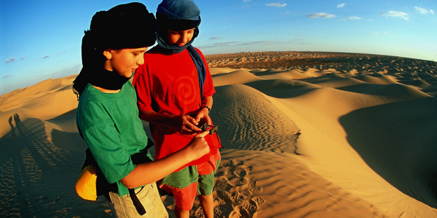 (GERMANY OUT) Tunisia - Boys on a trekking tour navigating in the Grand Erg Oriental.  (Photo by Knut Müller/ullstein bild via Getty Images)
