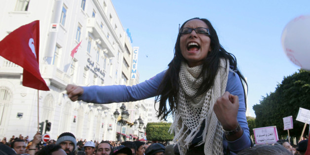 A protester clenches her fists as she shouts slogans during a protest in Tunis January 29, 2011. The protesters are calling for equality between men and women. REUTERS/Louafi Larbi (TUNISIA - Tags: POLITICS CIVIL UNREST SOCIETY)