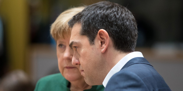 Alexis Tsipras, Greece's prime minister, right, and Angela Merkel, Germany's chancellor, speak ahead of round table talks during the European Union (EU) summit in Brussels, Belgium, on Friday, March 10, 2017. European Union leaders sent a clear signal that the 28-nation bloc will promote free trade, in a show of opposition to the protectionist stance floated by the new U.S. administration. Photographer: Jasper Juinen/Bloomberg via Getty Images