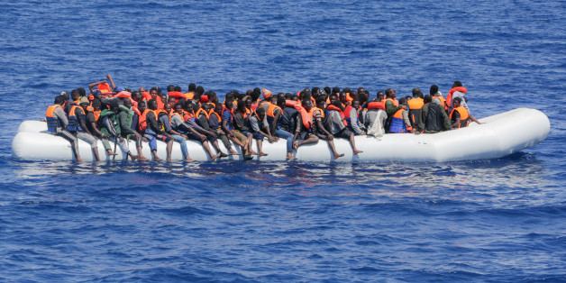 LAMPEDUSA, ITALY - MAY 19: Refugees and migrants are seen floating in an overcrowded rubber boat as they wait to be assisted by search and rescue crew members from NGO Sea-Eye on May 18, 2017 in international waters off the coast of Libya. (Photo by Christian Marquardt/NurPhoto via Getty Images)