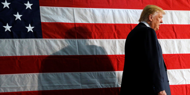 Republican presidential nominee Donald Trump takes the stage for a campaign rally in Colorado Springs, Colorado, U.S. October 18, 2016. REUTERS/Jonathan Ernst