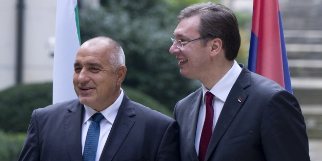 Romanian Prime Minister Victor Ponta (L) chats with Bulgarian Prime minister Boyko Borisov (C) and Serbian counterpart Aleksandar Vucic before their meeting in Sofia on October 24, 2015. The prime ministers of Serbia, Bulgaria and Romania hold talks today on how to tackle record numbers of migrants at the onset of winter, ahead of a mini-EU summit to discuss a coordinated response.  AFP PHOTO / NIKOLAY DOYCHINOV        (Photo credit should read NIKOLAY DOYCHINOV/AFP/Getty Images)