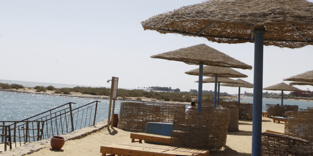 A tourist stands near an empty beach at the coast of the Red Sea of El-Gouna in Hurghada, about 464 km (288 miles) from the capital Cairo, September 11, 2013. According to Egypt's official statistics agency CAPMAS, there was a 25% drop in July 2013 in tourist visits to Egypt due to the country's political crisis. As result, government initiatives have been launched, such as low-priced packages for locals which include air tickets and accommodations in four and five star hotels, to encourage domestic tourism in hopes of increasing hotel occupancy rates, local media said. Picture taken September 11, 2013. REUTERS/Amr Abdallah Dalsh  (EGYPT - Tags: POLITICS TRAVEL BUSINESS)