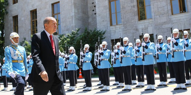 ANKARA, TURKEY - JULY 15: Turkish President Recep Tayyip Erdogan (front) walks past the honor guards during a welcoming ceremony as he arrives to attend the General Assembly of the Parliament, as part of the July 15 Democracy and National Unity Day, at Grand National Assembly of Turkey (TBMM), in Ankara, Turkey on June 15, 2017. (Photo by Kayhan Ozer/Anadolu Agency/Getty Images)
