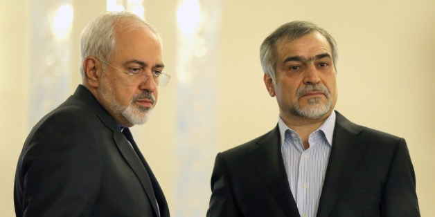 Iranian Foreign Minister Javad Zarif (L) and Hossein Fereydoun, President Rouhani's younger brother and advisor, look on during a press conference of President Hassan Rouhani (unseen) in Tehran on April 3, 2015. Iran vowed to stand by a nuclear deal with world powers as Rouhani promised it would open a 'new page' in the country's global ties.  AFP PHOTO/ATTA KENARE        (Photo credit should read ATTA KENARE/AFP/Getty Images)