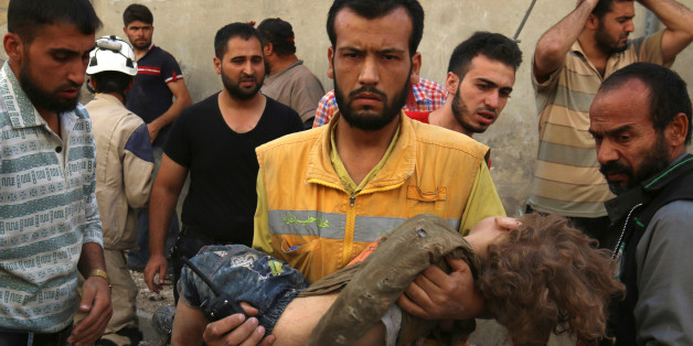 ATTENTION EDITORS - VISUAL COVERAGE OF SCENES OF INJURY OR DEATHA medic holds a dead child after airstrikes in the rebel held Karam Houmid neighbourhood in Aleppo, Syria October 4, 2016. REUTERS/Abdalrhman Ismail      TPX IMAGES OF THE DAY