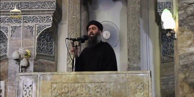 A man purported to be the reclusive leader of the militant Islamic State Abu Bakr al-Baghdadi has made what would be his first public appearance at a mosque in the centre of Iraq's second city, Mosul, according to a video recording posted on the Internet on July 5, 2014, in this still image taken from video. There had previously been reports on social media that Abu Bakr al-Baghdadi would make his first public appearance since his Islamic State in Iraq and the Levant (ISIL) changed its name to t