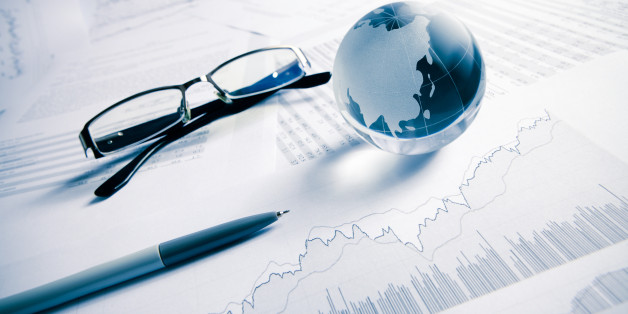 glass globe ( asia map)  with stock charts, pen and eye glass, business concept