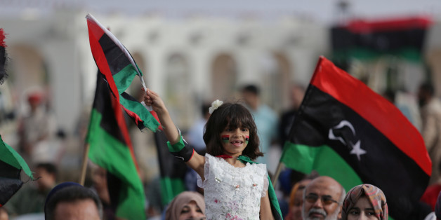 A girl holds a Libyan flag during celebrations marking the third anniversary of Libyan National Army's ÒDignityÓ operation against Islamists and other opponents, in Benghazi, Libya May 16, 2017. REUTERS/Esam Omran Al-Fetori