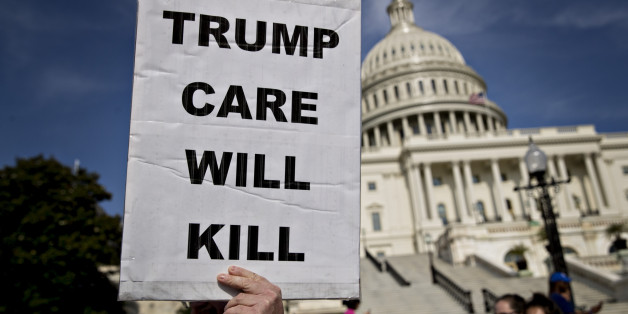 A demonstrator opposed to the Senate Republican health-care holds a sign that reads 'Trump Care Will Kill' while marching near the U.S. Capitol in Washington, D.C., U.S., on Wednesday, June 28, 2017. Several Senate Republicans began to question today whether their health-care bill should repeal a tax on high-income Americans imposed by Obamacare when the legislation would scale back subsidies for the poor. Photographer: Andrew Harrer/Bloomberg via Getty Images