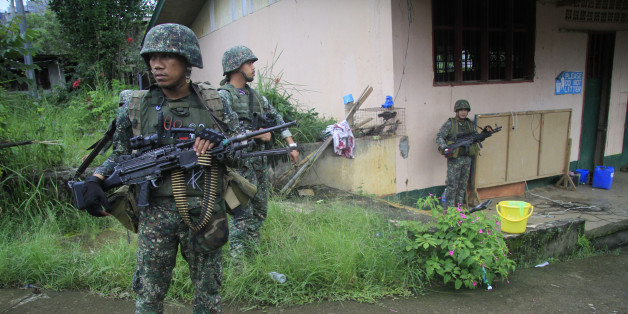 This photo taken on July 12, 2017 shows Philippine troops standing guard prior to a patrol in Marawi on the southern island of Mindanao. 