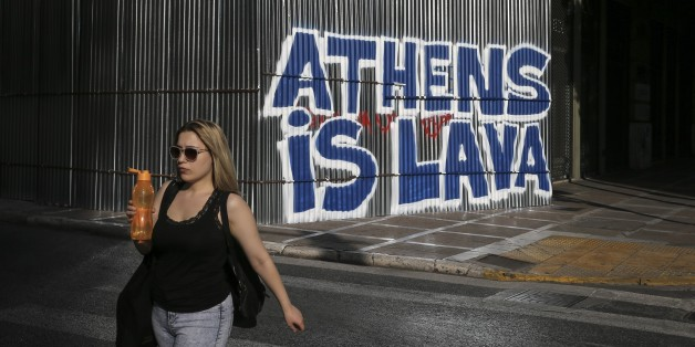 ATHENS, GREECE - JULY 1: People walk at the street during the hot summer day in Athens, Greece on July 1, 2017. (Photo by Ayhan Mehmet/Anadolu Agency/Getty Images)
