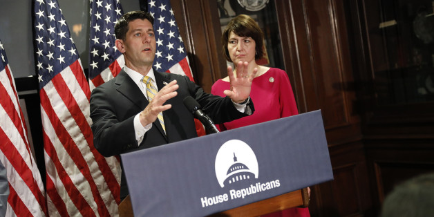 U.S. Speaker of the House Paul Ryan speaks to the press about President Donald Trump, former FBI Director James Comey and Russia investigations as Republican Conference Chairman Rep. Cathy McMorris Rodgers (R) looks on after a closed meeting of the Republican leadership of the House of Representatives on Capitol Hill in Washington, U.S. May 17, 2017. REUTERS/Aaron P. Bernstein