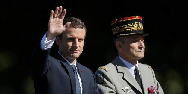 French President Emmanuel Macron and Chief of the Defence Staff French Army General Pierre de Villiers arrive in a command car for the traditional Bastille Day military parade on the Champs-Elysees in Paris, France, July 14, 2017.  REUTERS/Stephane Mahe