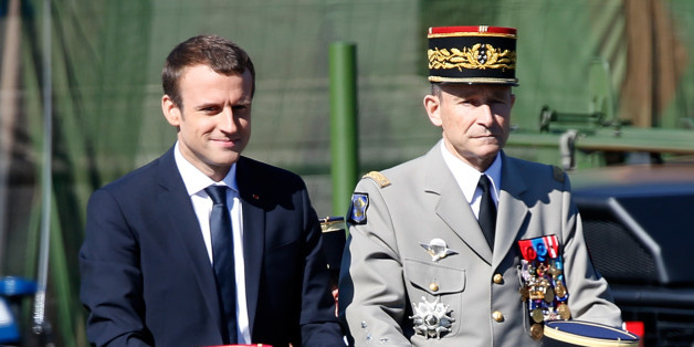 French President Emmanuel Macron (L) and Chief of the Defence Staff French Army General Pierre de Villiers (R) attend the traditional Bastille Day military parade on the Champs-Elysees in Paris, France, July 14, 2017. Picture taken July 14, 2017. REUTERS/Charles Platiau